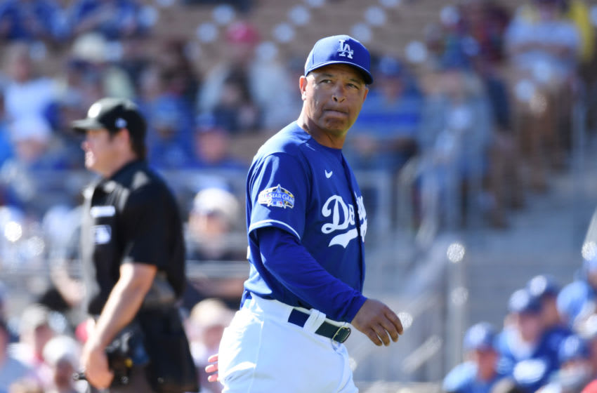GLENDALE, ARIZONA - FEBRUARY 26: Manager Dave Roberts #30 of the Los Angeles Dodgers walks back to the dugout after making a pitching change during the fourth inning of a spring training game against the Los Angeles Angels at Camelback Ranch on February 26, 2020 in Glendale, Arizona. (Photo by Norm Hall/Getty Images)
