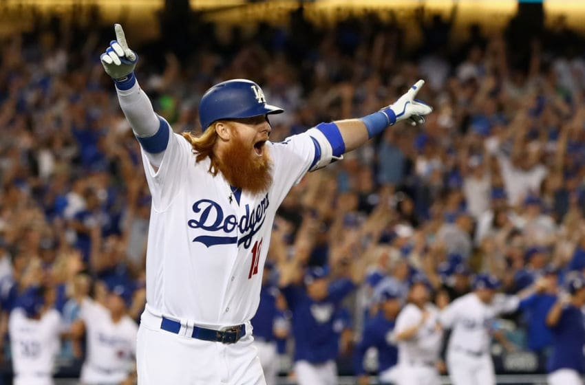 LOS ANGELES, CA - OCTOBER 15: Justin Turner #10 of the Los Angeles Dodgers celebrates after hitting the winning home run in the bottom of the ninth inning making the score 4-1 during Game Two of the National League Championship Series against the Chicago Cubs at Dodger Stadium on October 15, 2017 in Los Angeles, California. (Photo by Ezra Shaw/Getty Images)
