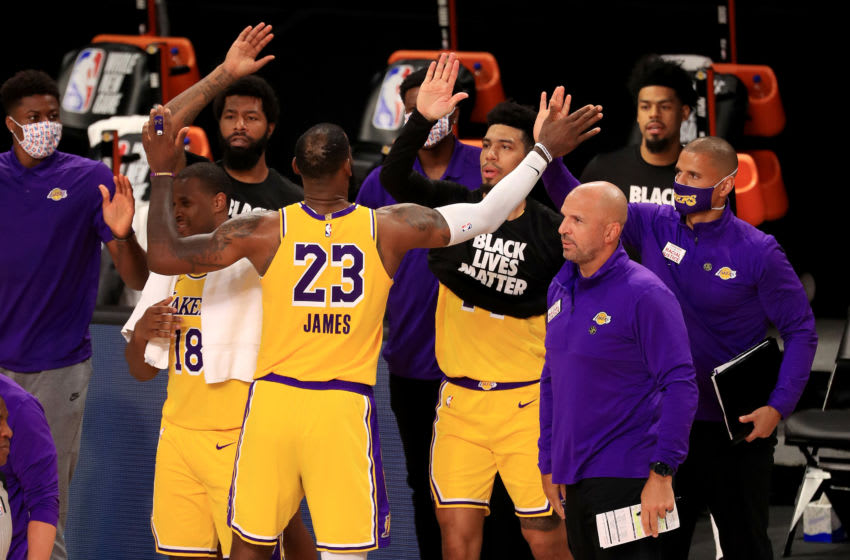 LAKE BUENA VISTA, FLORIDA - JULY 30: LeBron James #23 of the Los Angeles Lakers celebrates with his teammates after defeating the LA Clippers after the game at The Arena at ESPN Wide World Of Sports Complex on July 30, 2020 in Lake Buena Vista, Florida. NOTE TO USER: User expressly acknowledges and agrees that, by downloading and or using this photograph, User is consenting to the terms and conditions of the Getty Images License Agreement. (Photo by Mike Ehrmann/Getty Images)