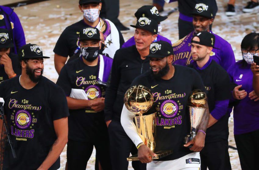 LAKE BUENA VISTA, FLORIDA - OCTOBER 11: LeBron James #23 of the Los Angeles Lakers reacts with his MVP trophy and Finals trophy after winning the 2020 NBA Championship over the Miami Heat in Game Six of the 2020 NBA Finals at AdventHealth Arena at the ESPN Wide World Of Sports Complex on October 11, 2020 in Lake Buena Vista, Florida. NOTE TO USER: User expressly acknowledges and agrees that, by downloading and or using this photograph, User is consenting to the terms and conditions of the Getty Images License Agreement. (Photo by Mike Ehrmann/Getty Images)