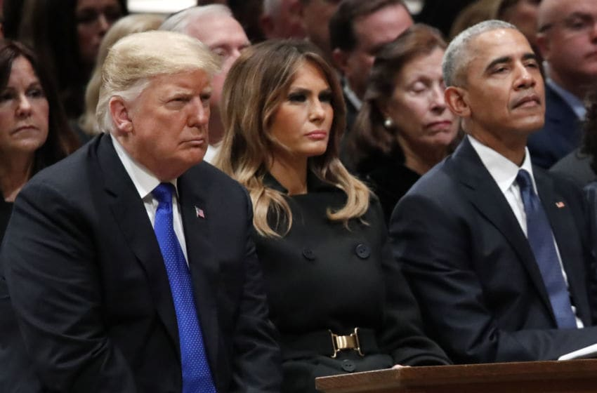 WASHINGTON, DC - DECEMBER 05: (AFP OUT) President Donald Trump, first lady Melania Trump and former President Barack Obama listen as former Canadian Prime Minister Brian Mulroney speaks during the state funeral for former U.S. President George H. W. Bush at the Washington National Cathedral on December 5, 2018 in Washington, DC. President Bush will be buried at his final resting place at the George H.W. Bush Presidential Library at Texas A&M University in College Station, Texas. A WWII combat veteran, Bush served as a member of Congress from Texas, ambassador to the United Nations, director of the CIA, vice president and 41st president of the United States. (Photo by Alex Brandon - Pool/Getty Images)
