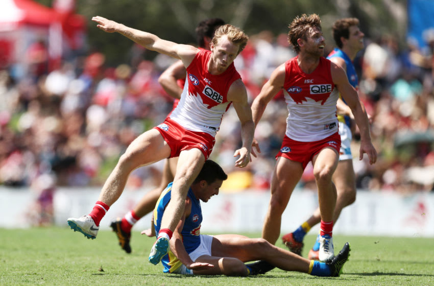 LISMORE, AUSTRALIA - MARCH 10: Ben Ainsworth of the Suns collides with Callum Mills of the Swans after kicking a goal during the 2019 JLT Community Series AFL match between the Sydney Swans and the Gold Coast Suns at Oakes Oval on March 10, 2019 in Lismore, Australia. (Photo by Matt King/Getty Images)