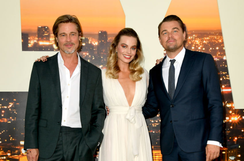 HOLLYWOOD, CALIFORNIA - JULY 22: (L-R) Brad Pitt, Margot Robbie and Leonardo DiCaprio arrive at the premiere of Sony Pictures'