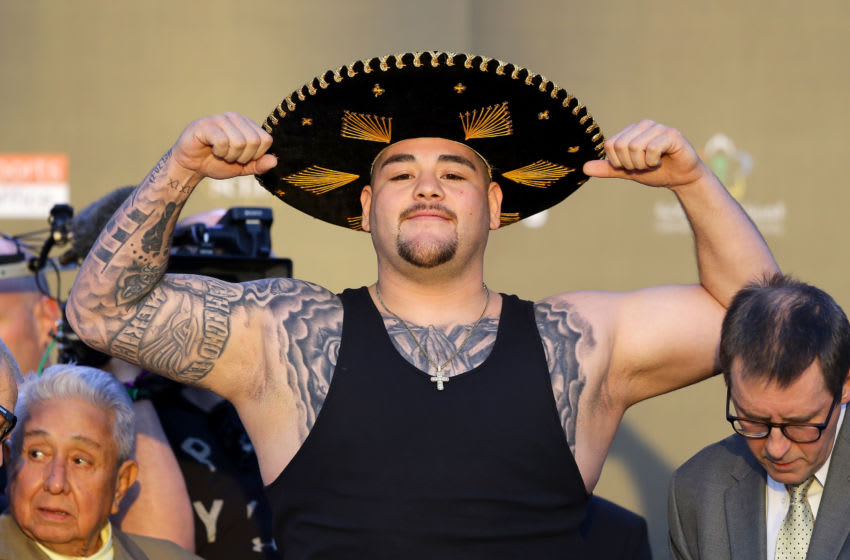 RIYADH, SAUDI ARABIA - DECEMBER 06: Andy Ruiz Jr poses for photos as he weighs in ahead of the IBF, WBA, WBO & IBO World Heavyweight Title Fight between Andy Ruiz Jr and Anthony Joshua during the Clash on the Dunes Weigh In at the the Al Faisaliah Hotel on December 06, 2019 in Riyadh, Saudi Arabia. (Photo by Richard Heathcote/Getty Images)