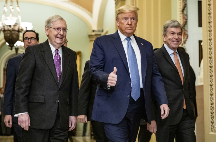 President Donald Trump with GOP lawmakers (Photo by Samuel Corum/Getty Images)