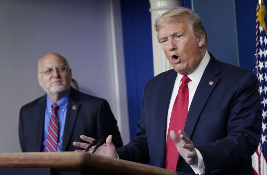 President Donald Trump flanked by Dr. Robert Redfield, (Photo by Drew Angerer/Getty Images)
