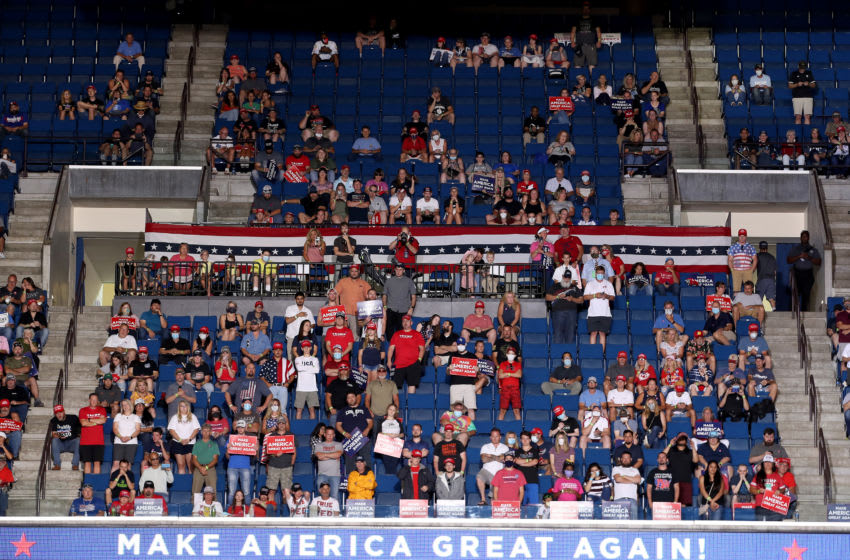 Supporters listen as U.S. President Donald Trump speaks in Tulsa, Oklahoma (Photo by Win McNamee/Getty Images)
