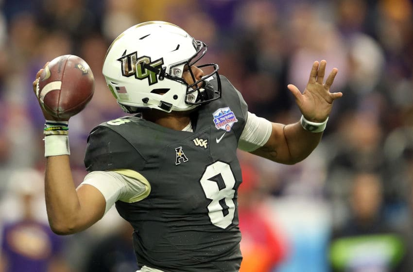 GLENDALE, ARIZONA - JANUARY 01: Quarterback Darriel Mack Jr. #8 of the UCF Knights throws a pass during the third quarter of the PlayStation Fiesta Bowl between LSU and Central Florida at State Farm Stadium on January 01, 2019 in Glendale, Arizona. (Photo by Christian Petersen/Getty Images)
