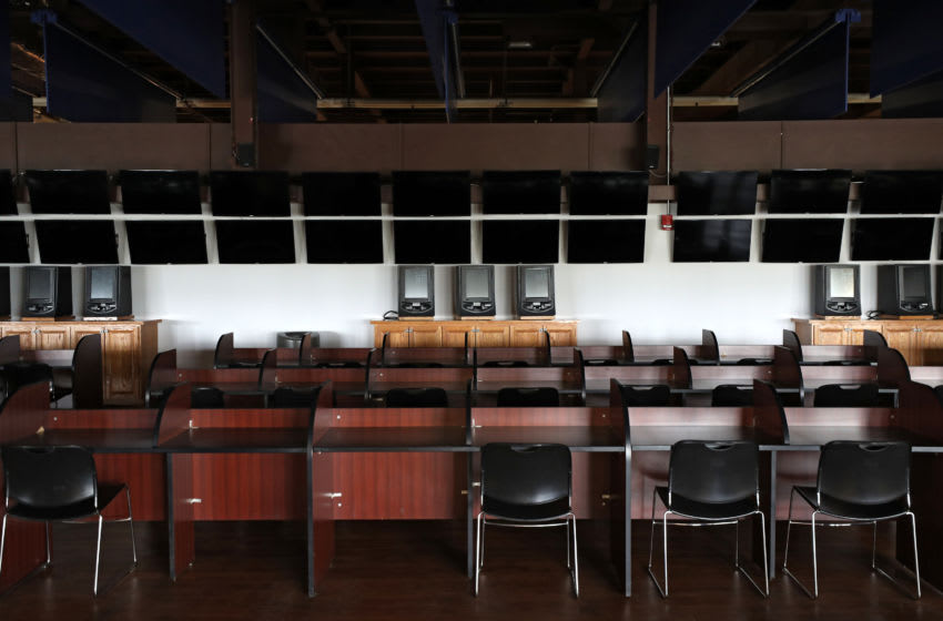 LAUREL, MARYLAND - MARCH 15: Televisions and betting machines are seen turned off during live horse racing without fans in attendance due to Coronavirus at Laurel Park on March 15, 2020 in Laurel, Maryland. Nearly all of professional sports worldwide have been canceled or postposed because of the Coronavirus pandemic - except for horse racing. Today Maryland Gov. Larry Hogan issued an emergency order to close all Maryland casinos, racetracks, and simulcast betting facilities to the general public due to COVID-19. This order goes into effect at midnight on Monday, March 16. (Photo by Patrick Smith/Getty Images)