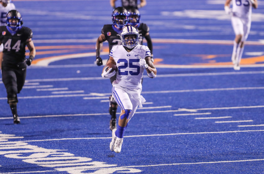BOISE, ID - NOVEMBER 6: Running back Tyler Allgeier #25 of the BYU Cougars runs for a touchdown during the first half against the Boise State Broncos at Albertsons Stadium on November 6, 2020 in Boise, Idaho. (Photo by Loren Orr/Getty Images)