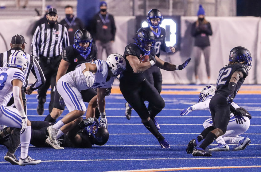 BOISE, ID - NOVEMBER 6: Running back Andrew Van Buren #21 of the Boise State Broncos breaks through the BYU Cougars' defensive line during first half action at Albertsons Stadium on November 6, 2020 in Boise, Idaho. (Photo by Loren Orr/Getty Images)