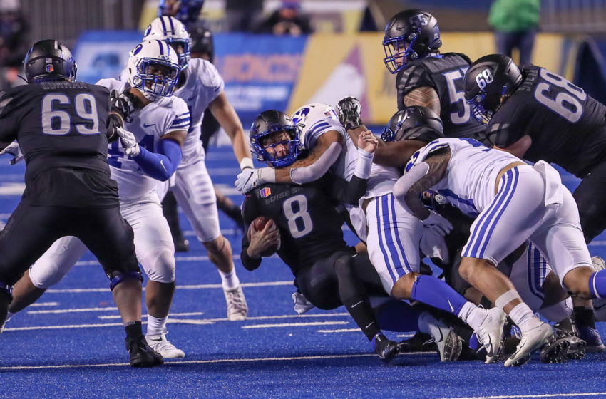 BOISE, ID - NOVEMBER 6: Quarterback Cade Fennegan #8 of the Boise State Broncos gets sacked during second half action against the BYU Cougars at Albertsons Stadium on November 6, 2020 in Boise, Idaho. BYU won the game 51-17. (Photo by Loren Orr/Getty Images)
