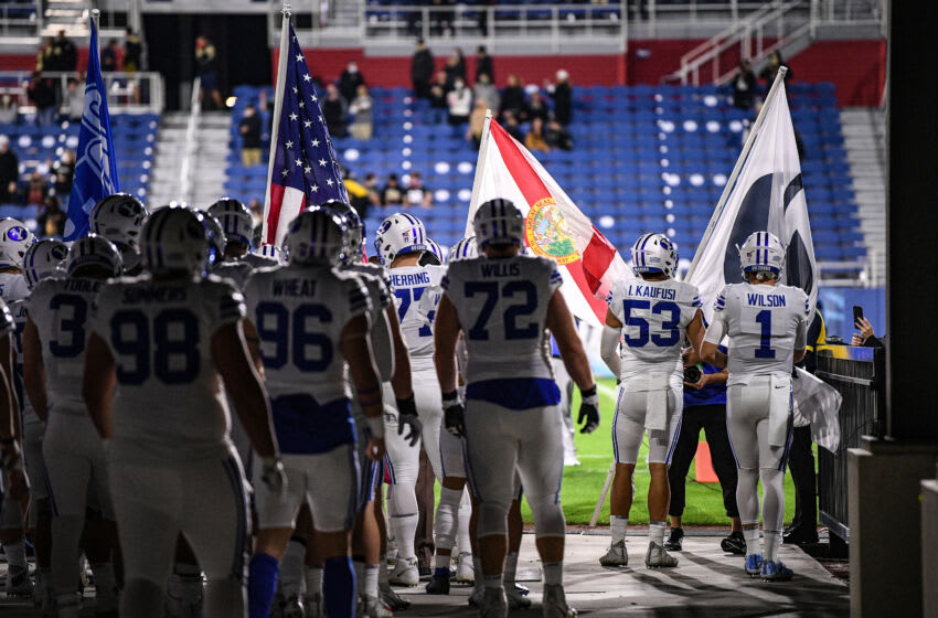 BOCA RATON, FLORIDA - DECEMBER 22: Zach Wilson #1 and the Brigham Young Cougars wait to take the field prior to the game against the Central Florida Knights at FAU Stadium on December 22, 2020 in Boca Raton, Florida. (Photo by Mark Brown/Getty Images)