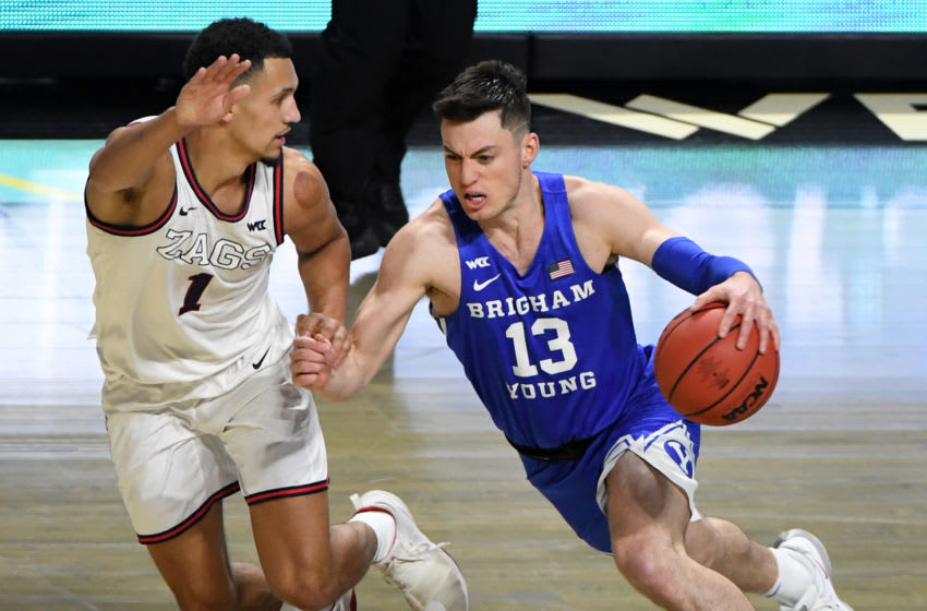 LAS VEGAS, NEVADA - MARCH 09: Alex Barcello #13 of the Brigham Young Cougars drives against Jalen Suggs #1 of the Gonzaga Bulldogs during the championship game of the West Coast Conference basketball tournament at the Orleans Arena on March 9, 2021 in Las Vegas, Nevada. The Bulldogs defeated the Cougars 88-78. (Photo by Ethan Miller/Getty Images)