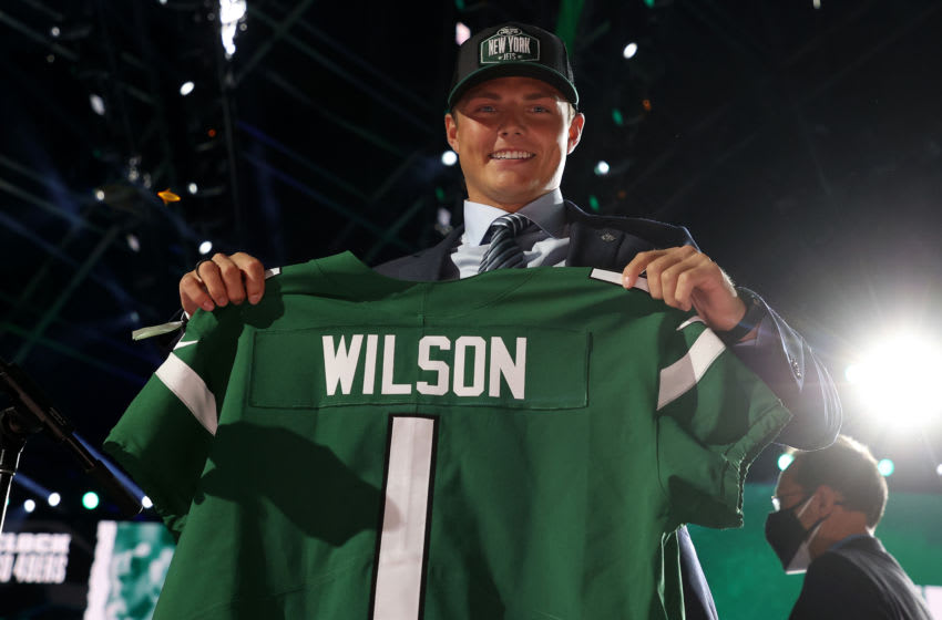 CLEVELAND, OHIO - APRIL 29: Zach Wilson holds a jersey onstage after being drafted second by the New York Jets during round one of the 2021 NFL Draft at the Great Lakes Science Center on April 29, 2021 in Cleveland, Ohio. (Photo by Gregory Shamus/Getty Images)