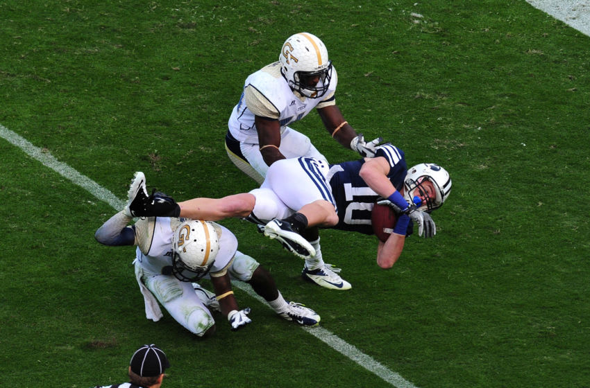 ATLANTA, GA - OCTOBER 27: Mitch Matthews #10 of the BYU Cougars is tackled by Jemea Thomas #14 and Rod Sweeting #6 of the Georgia Tech Yellow Jackets at Bobby Dodd Stadium on October 27, 2012 in Atlanta, Georgia. (Photo by Scott Cunningham/Getty Images)