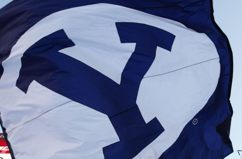SALT LAKE CITY, UT - SEPTEMBER 10: A flag for the Brigham Young Cougars enters the field of play for their game against the Utah Utes, at Rice Eccles Stadium on September 10, 2016 in Salt Lake City, Utah. (Photo by George Frey/Getty Images)