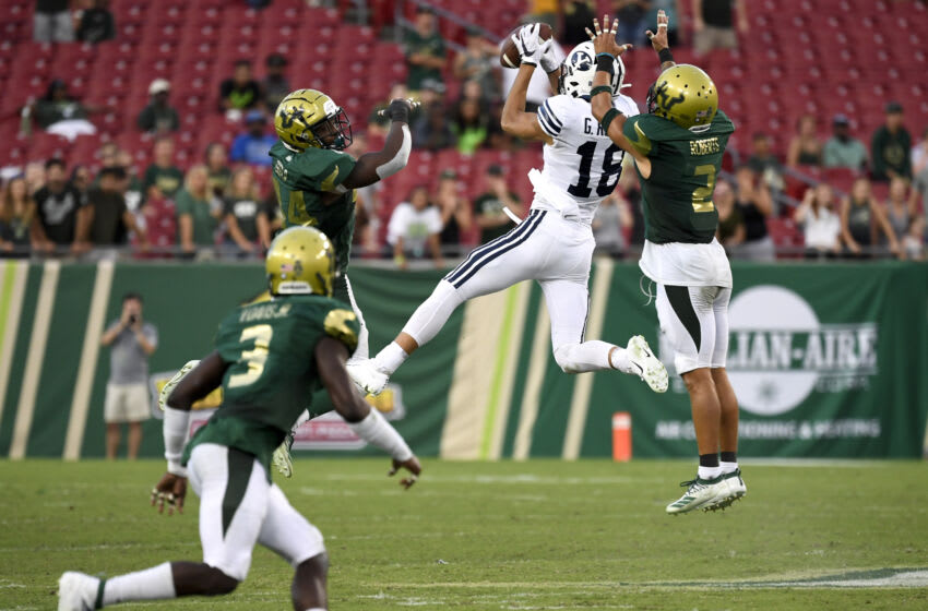 Oct 12, 2019; Tampa, FL, USA; Brigham Young Cougars wide receiver Gunner Romney (18) receives the ball in front of South Florida defensive back Nick Roberts (2) during the fourth quarter at Raymond James Stadium. Mandatory Credit: Douglas DeFelice-USA TODAY Sports