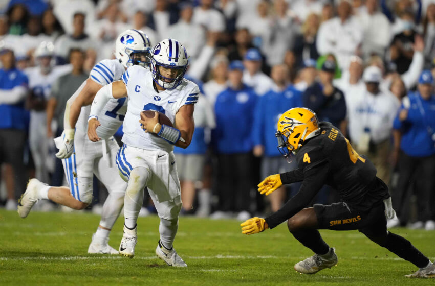Sep 18, 2021; Provo, Utah, USA; BYU Cougars quarterback Jaren Hall (3) is pursued by Arizona State Sun Devils defensive back Evan Fields (4) in the fourth quarter at LaVell Edwards Stadium. Mandatory Credit: Kirby Lee-USA TODAY Sports