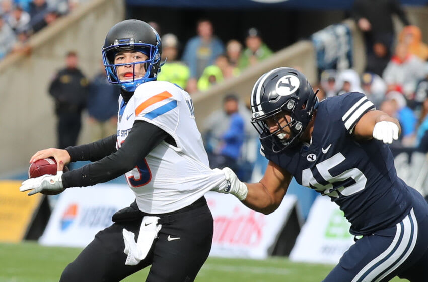 Oct 9, 2021; Provo, Utah, USA; Boise State Broncos quarterback Hank Bachmeier (19) is pressured by Brigham Young Cougars defensive lineman Pepe Tanuvasa (45) during the third quarter at LaVell Edwards Stadium. Mandatory Credit: Rob Gray-USA TODAY Sports
