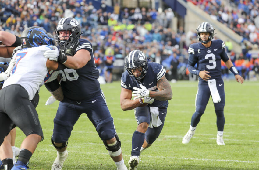 Oct 9, 2021; Provo, Utah, USA; Brigham Young Cougars running back Tyler Allgeier (25) runs the ball in the third quarter against the Boise State Broncos at LaVell Edwards Stadium. Mandatory Credit: Rob Gray-USA TODAY Sports