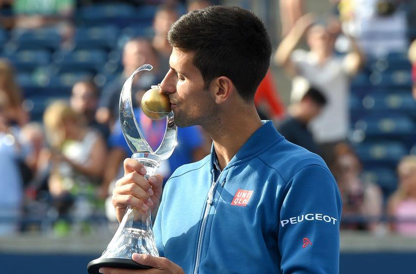 Jul 31, 2016; Toronto, Ontario, Canada; Novak Djokovic of Serbia kisses the champions trophy after defeating Kei Nishikori of Japan to win the Rogers Cup tennis tournament at Aviva Centre. Mandatory Credit: Dan Hamilton-USA TODAY Sports