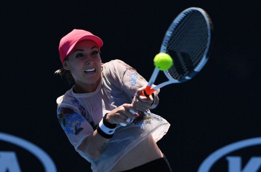 Bethanie Mattek-Sands of the US hits a return against Australia's Zoe Hives during their women's singles match on day one of the Australian Open tennis tournament in Melbourne on January 14, 2019. (Photo by Paul Crock / AFP) / -- IMAGE RESTRICTED TO EDITORIAL USE - STRICTLY NO COMMERCIAL USE -- (Photo credit should read PAUL CROCK/AFP via Getty Images)