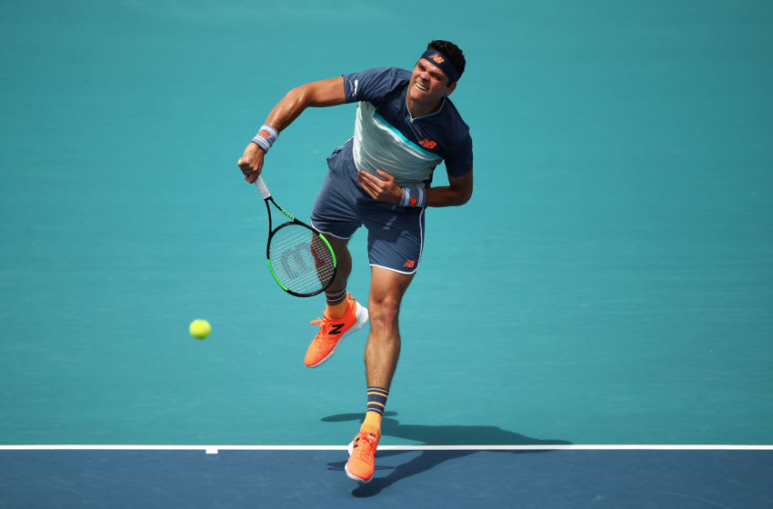 MIAMI GARDENS, FLORIDA - MARCH 24: Milos Raonic of Canada in action against Kyle Edmund of Great Britain during day seven at the Miami Open Tennis on March 24, 2019 in Miami Gardens, Florida. (Photo by Julian Finney/Getty Images)