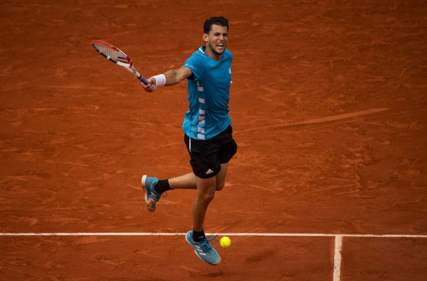 PARIS, FRANCE - JUNE 09: Dominic Thiem of Austria hits a backhand against Rafael Nadal of Spain in the final of the men's singles during Day 15 of the 2019 French Open at Roland Garros on June 09, 2019 in Paris, France. (Photo by TPN/Getty Images)