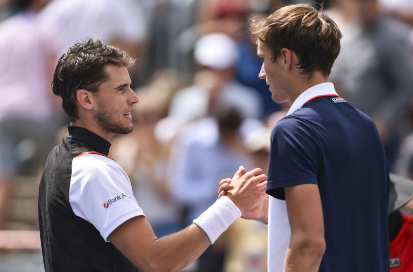 MONTREAL, QC - AUGUST 09: Dominic Thiem of Austria congratulates Daniil Medvedev of Russia for his victory during day 8 of the Rogers Cup at IGA Stadium on August 9, 2019 in Montreal, Quebec, Canada. Daniil Medvedev of Russia defeated Dominic Thiem of Austria 6-3, 6-1. (Photo by Minas Panagiotakis/Getty Images)