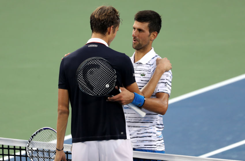 MASON, OHIO - AUGUST 17: Daniil Medvedev of Russia (L) shakes hands with Novak Djokovic of Serbia after defeating him in three sets during Day 8 of the Western and Southern Open at Lindner Family Tennis Center on August 17, 2019 in Mason, Ohio. (Photo by Rob Carr/Getty Images)