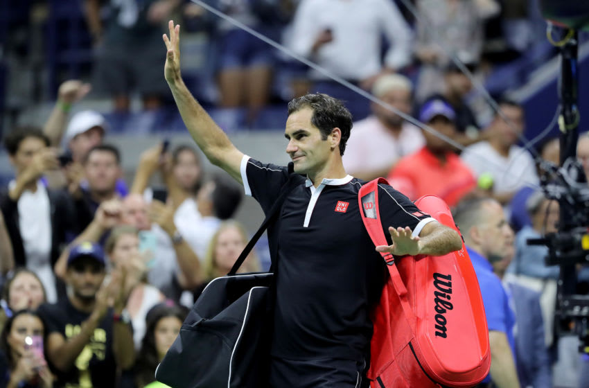 Roger Federer of Switzerland waves to the fans as he walks off the court after his loss to Grigor Dimitrov of Bulgaria during quarterfinal Men's Singles match on day nine of the 2019 US Open at the USTA Billie Jean King National Tennis Center on September 3, 2019 in Queens borough of New York City.(Photo by Elsa/Getty Images)