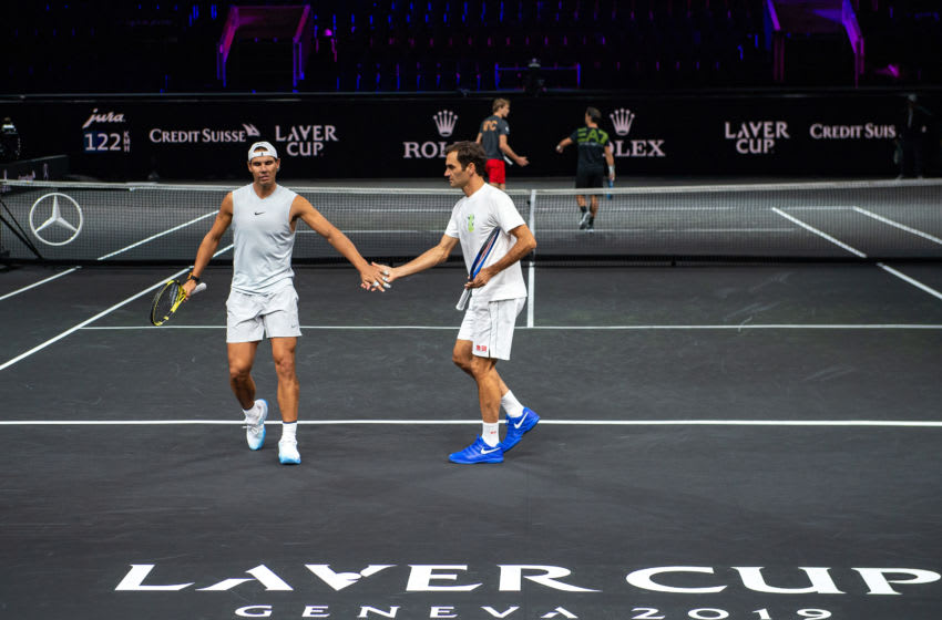 GENEVA, SWITZERLAND - SEPTEMBER 18: Roger Federer (R) and Rafael Nadal of Team Europe celebrate in a practice session during previews ahead of the Laver Cup 2019 at Palexpo on September 18, 2019 in Geneva, Switzerland. The Laver Cup consists of six players from the rest of the World competing against their counterparts from Europe. John McEnroe will captain the Rest of the World team and Europe will be captained by Bjorn Borg. The event runs from 20-22 Sept. (Photo by Robert Hradil/Getty Images for Laver Cup)