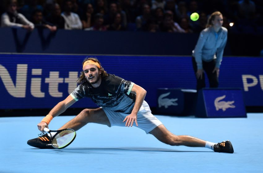 Greece's Stefanos Tsitsipas returns against Austria's Dominic Thiem during the men's singles final match on day eight of the ATP World Tour Finals tennis tournament at the O2 Arena in London on November 17, 2019. - Tsitsipas beat Austria's Dominic Thiem to win the match 6-7, 6-2, 7-6. (Photo by Glyn KIRK / AFP) (Photo by GLYN KIRK/AFP via Getty Images)