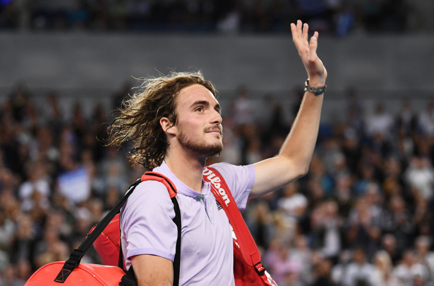 MELBOURNE, AUSTRALIA - JANUARY 20: Stefanos Tsitsipas of Greece celebrates winning his Men's Singles first round match against Salvatore Caruso of Italy on day one of the 2020 Australian Open at Melbourne Park on January 20, 2020 in Melbourne, Australia. (Photo by Hannah Peters/Getty Images)