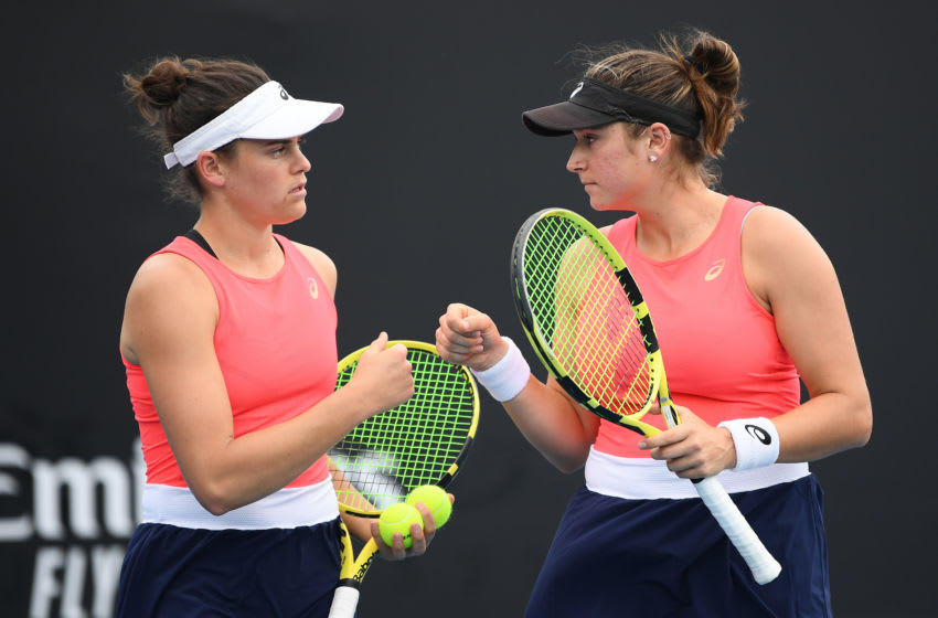 MELBOURNE, AUSTRALIA - JANUARY 22: Jennifer Brady and Caroline Dolehide of the United States talk tactics during their Women's Doubles first round match against Nicole Melichar of the United States and Yifan Xu of China on day three of the 2020 Australian Open at Melbourne Park on January 22, 2020 in Melbourne, Australia. (Photo by Hannah Peters/Getty Images)