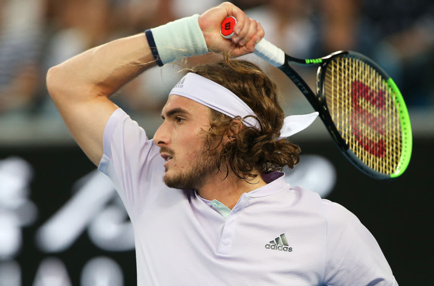 MELBOURNE, AUSTRALIA - JANUARY 24: Stefanos Tsitsipas of Greece plays a shot during his Men's Singles third round match against Milos Raonic of Canada on day five of the 2020 Australian Open at Melbourne Park on January 24, 2020 in Melbourne, Australia. (Photo by Jack Thomas/Getty Images)