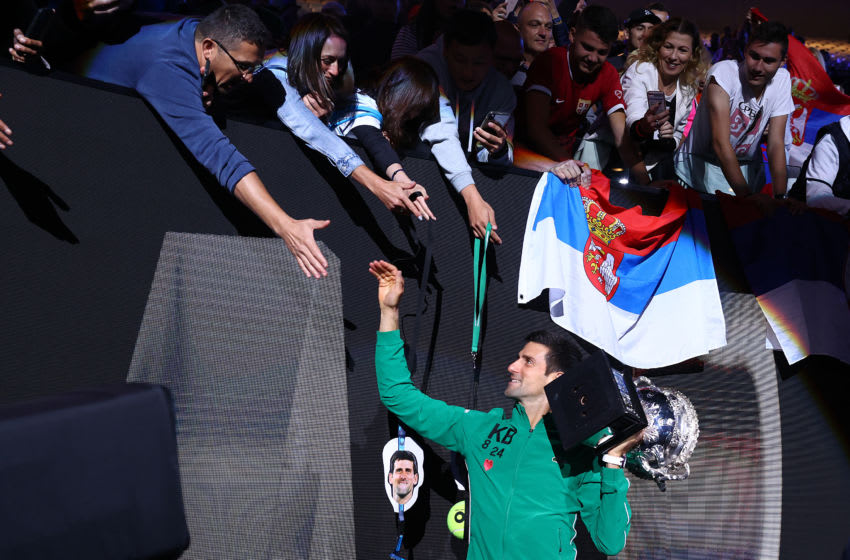 MELBOURNE, AUSTRALIA - FEBRUARY 02: Novak Djokovic of Serbia celebrates with the fans after winning the Men's Singles Final match against Dominic Thiem of Austria on day fourteen of the 2020 Australian Open at Melbourne Park on February 02, 2020 in Melbourne, Australia. (Photo by Cameron Spencer/Getty Images)