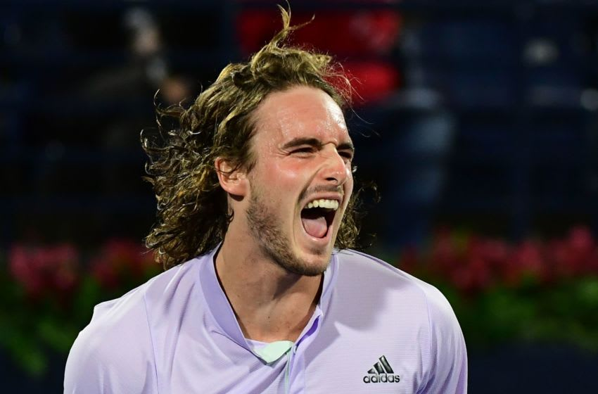 Greece's Stefanos Tsitsipas celebrates during the quarter-finals of the Dubai Duty Free Tennis Championship in the Gulf emirate of Dubai on February 27, 2020. (Photo by - / AFP) (Photo by -/AFP via Getty Images)