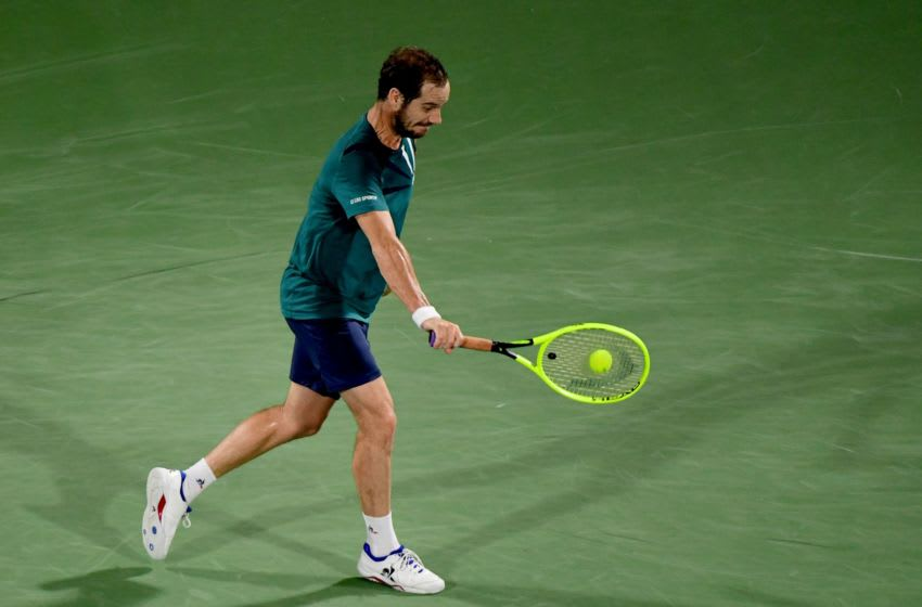 France's Richard Gasquet returns the ball to Gael Monfils of France during the quarter-finals of the Dubai Duty Free Tennis Championship in the Gulf emirate of Dubai on February 27, 2020. (Photo by - / AFP) (Photo by -/AFP via Getty Images)