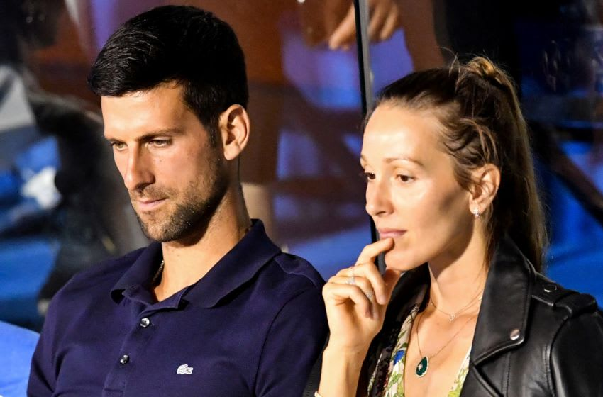 Serbian tennis player Novak Djokovic (L) talks to his wife Jelena during a match at the Adria Tour, Novak Djokovic's Balkans charity tennis tournament in Belgrade on June 14, 2020. - Novak Djokovic has also tested positive for coronavirus on June 23, 2020 along with Grigor Dimitrov, Borna Coric and Viktor Troicki, after taking part in an exhibition tennis tournament in the Balkans featuring world number one Novak Djokovic, raising questions over the sport's planned return in August. (Photo by Andrej ISAKOVIC / AFP) (Photo by ANDREJ ISAKOVIC/AFP via Getty Images)
