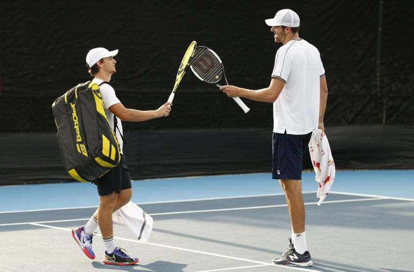 WEST PALM BEACH, FLORIDA - MAY 09: Miomir Kecmanovic of Serbia and Reilly Opelka of the United States tap their rackets together after their match in the UTR Pro Match Series Day 2 on May 09, 2020 in West Palm Beach, Florida. (Photo by Michael Reaves/Getty Images)