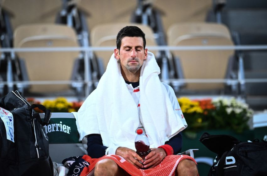 Serbia's Novak Djokovic reacts in the bench as he plays against Spain's Pablo Carreno Busta during their men's singles quarter-final tennis match on Day 11 of The Roland Garros 2020 French Open tennis tournament in Paris on October 7, 2020. (Photo by Anne-Christine POUJOULAT / AFP) (Photo by ANNE-CHRISTINE POUJOULAT/AFP via Getty Images)