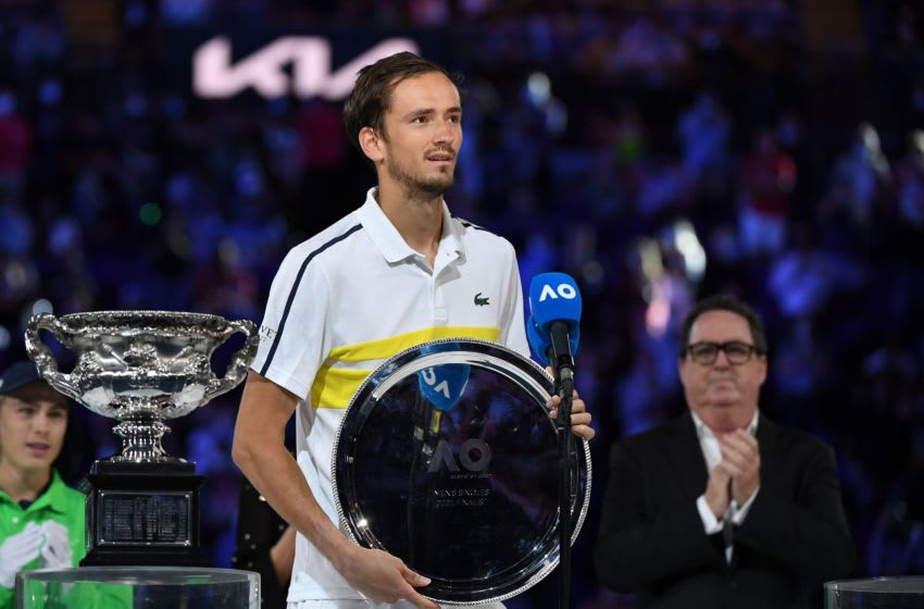 Russia's Daniil Medvedev poses with the runner-up trophy after losing against Serbia's Novak Djokovic during their men's singles final match on day fourteen of the Australian Open tennis tournament in Melbourne on February 21, 2021. (Photo by William WEST / AFP) / -- IMAGE RESTRICTED TO EDITORIAL USE - STRICTLY NO COMMERCIAL USE -- (Photo by WILLIAM WEST/AFP via Getty Images)