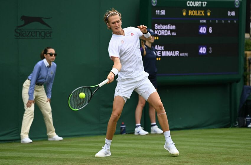 US player Sebastian Korda returns to Australia's Alex de Minaur during their men's singles first round match on the second day of the 2021 Wimbledon Championships at The All England Tennis Club in Wimbledon, southwest London, on June 29, 2021. - - RESTRICTED TO EDITORIAL USE (Photo by Glyn KIRK / AFP) / RESTRICTED TO EDITORIAL USE (Photo by GLYN KIRK/AFP via Getty Images)