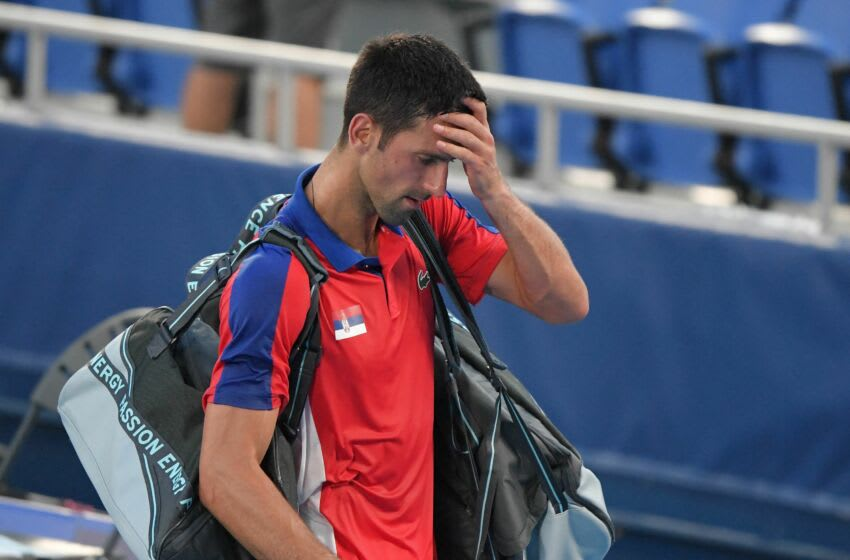Serbia's Novak Djokovic leaves after losing to Spain's Pablo Carreno Busta the Tokyo 2020 Olympic Games men's singles tennis match for the bronze medal at the Ariake Tennis Park in Tokyo on July 31, 2021. (Photo by Tiziana FABI / AFP) (Photo by TIZIANA FABI/AFP via Getty Images)
