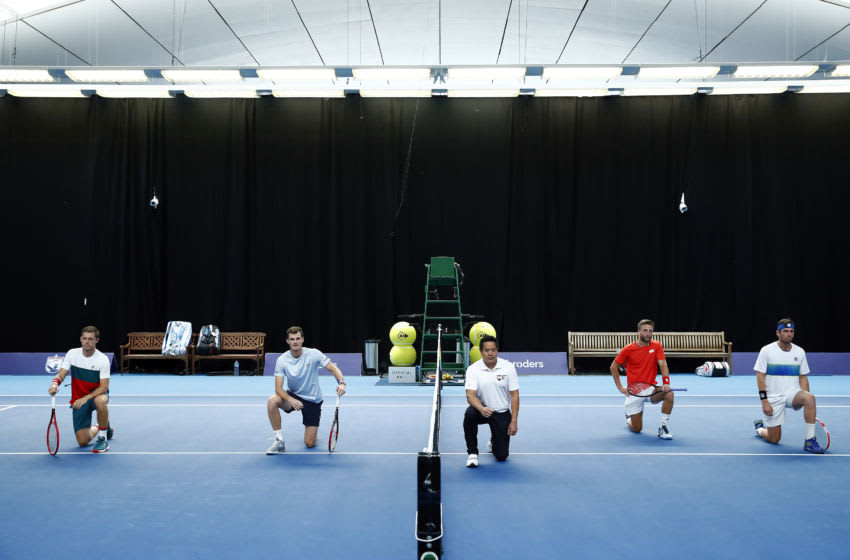 LONDON, ENGLAND - JUNE 23: Players take a knee, in solidarity with the BLM campaign, prior to match one between Jamie Murray & Neal Skupski and Liam Broady & Cameron Norrie on day 1 of Schroders Battle of the Brits at National Tennis Centre on June 23, 2020 in London, England. (Photo by Clive Brunskill/Getty Images for Battle Of The Brits)
