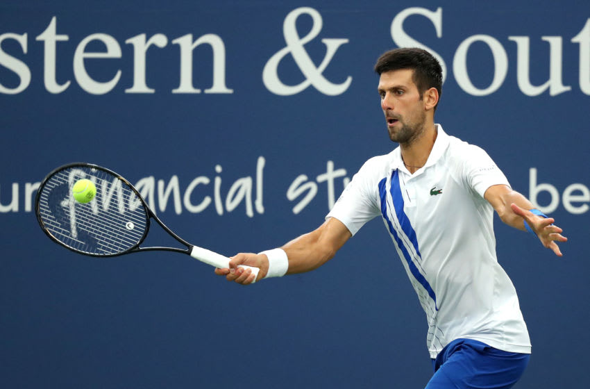 NEW YORK, NEW YORK - AUGUST 29: Novak Djokovic of Serbia returns a shot against Milos Raonic of Canada in their Men's Singles Final match of the 2020 Western & Southern Open at USTA Billie Jean King National Tennis Center on August 29, 2020 in the Queens borough of New York City. (Photo by Matthew Stockman/Getty Images)