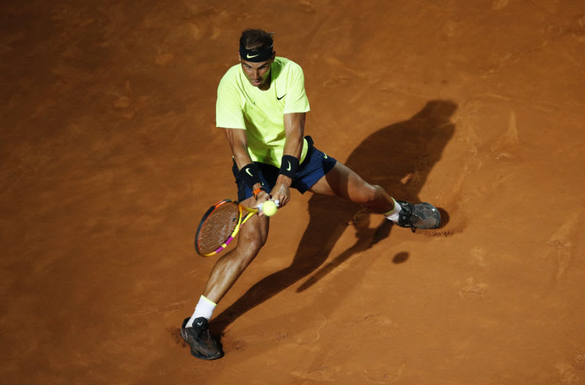 ROME, ITALY - SEPTEMBER 16: Rafael Nadal of Spain stretches to play a backhand in his round two match against Pablo Carreno Busta of Spain during day three of the Internazionali BNL d'Italia at Foro Italico on September 16, 2020 in Rome, Italy. (Photo by Clive Brunskill/Getty Images)