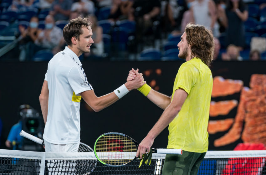 MELBOURNE, AUSTRALIA - FEBRUARY 19: Daniil Medvedev of Russia and Stefanos Tsitsipas of Greece embrace at the net following their Men's Singles Semifinals match during day 12 of the 2021 Australian Open at Melbourne Park on February 19, 2021 in Melbourne, Australia. (Photo by Andy Cheung/Getty Images)